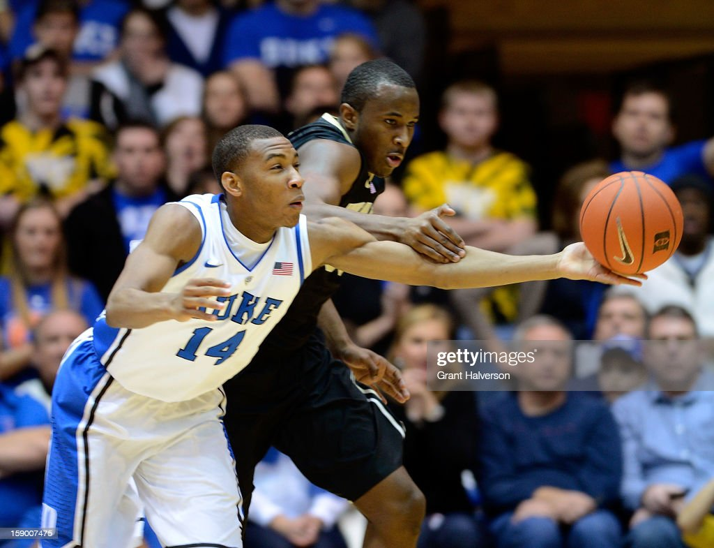 Rasheed Sulaimon #14 of the Duke Blue Devils battles for a loose ball with Travis McKie #30 of the Wake Forest Demon Deacons during play at Cameron Indoor Stadium on January 5, 2013 in Durham, North Carolina.