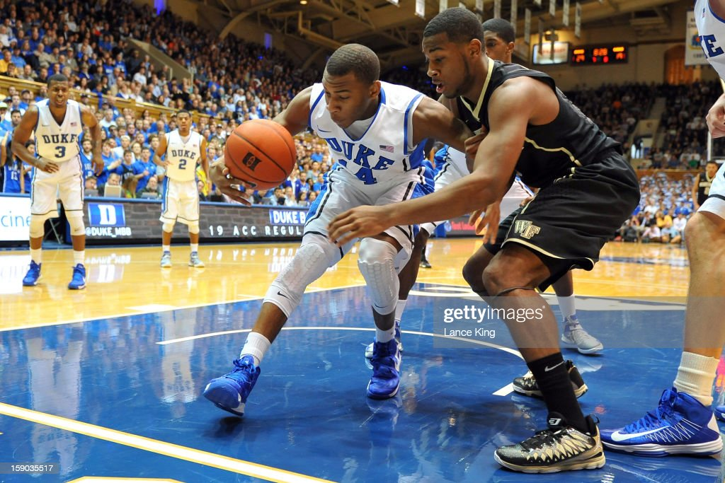 Rasheed Sulaimon #14 of the Duke Blue Devils gets a defensive rebound against Codi Miller-McIntyre #0 of the Wake Forest Demon Deacons at Cameron Indoor Stadium on January 5, 2013 in Durham, North Carolina. Duke defeated Wake Forest 80-62.