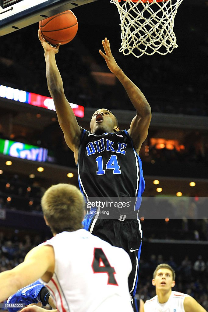 <a gi-track='captionPersonalityLinkClicked' href=/galleries/search?phrase=Rasheed+Sulaimon&family=editorial&specificpeople=7887134 ng-click='$event.stopPropagation()'>Rasheed Sulaimon</a> #14 of the Duke Blue Devils goes to the hoop against the Davidson Wildcats at Time Warner Cable Arena on January 2, 2013 in Charlotte, North Carolina.