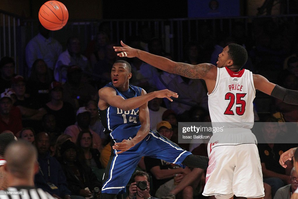 Rasheed Sulaimon #14 of the Duke Blue Devils passes against Zach Price #25 of the Louisville Cardinals during the Battle 4 Atlantis tournament at Atlantis Resort November 24, 2012 in Nassau, Paradise Island, Bahamas.
