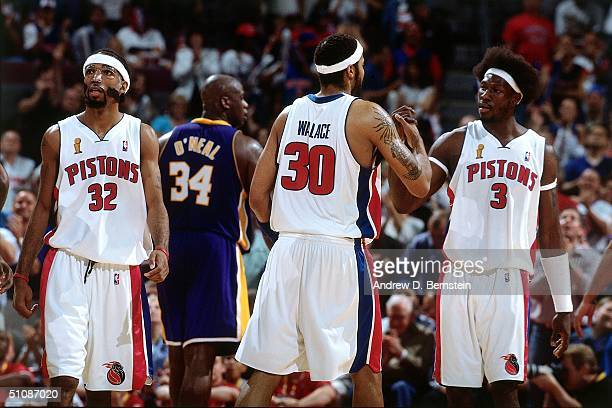 Rasheed Wallace and Ben Wallace of the Detroit Pistons shake hands during Game Four of the 2004 NBA Finals on June 13 2004 at The Palace of Auburn...
