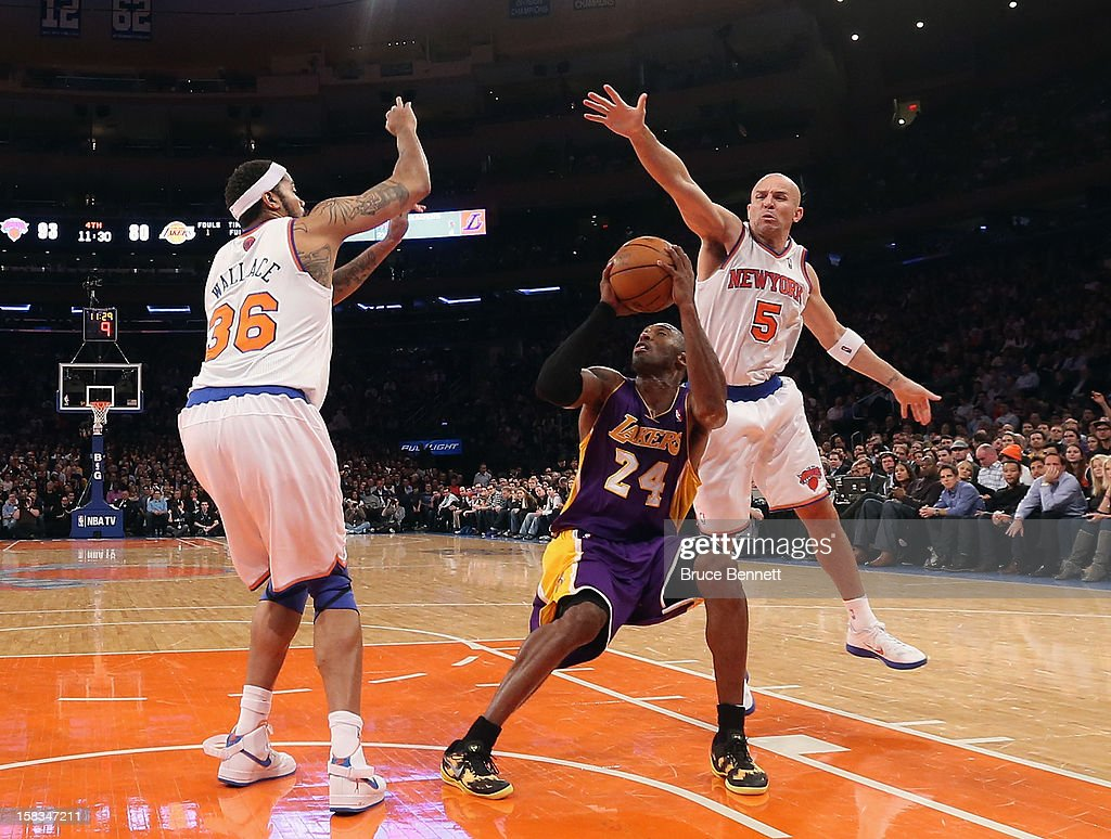 Rasheed Wallace #36 and Jason Kidd #5 of the New York Knicks defend against Kobe Bryant #24 of the Los Angeles Lakers at Madison Square Garden on December 13, 2012 in New York City.
