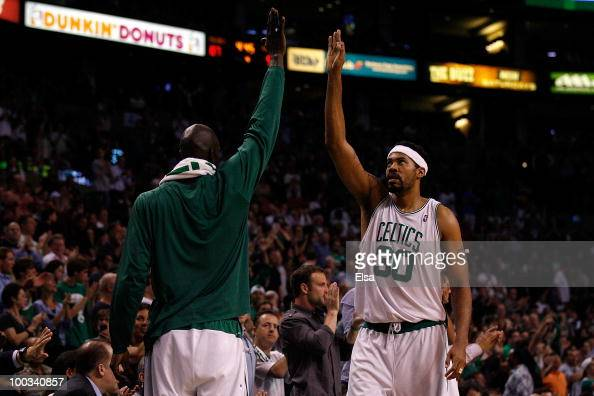 Rasheed Wallace and Kevin Garnett of the Boston Celtics celebrate a play against the Orlando Magic at TD Banknorth Garden in Game Three of the...