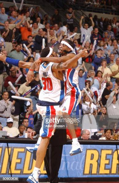 Rasheed Wallace and Richard Hamilton of the Detroit Pistons celebrate a basket against the Indiana Pacers in game three of the Eastern Conference...