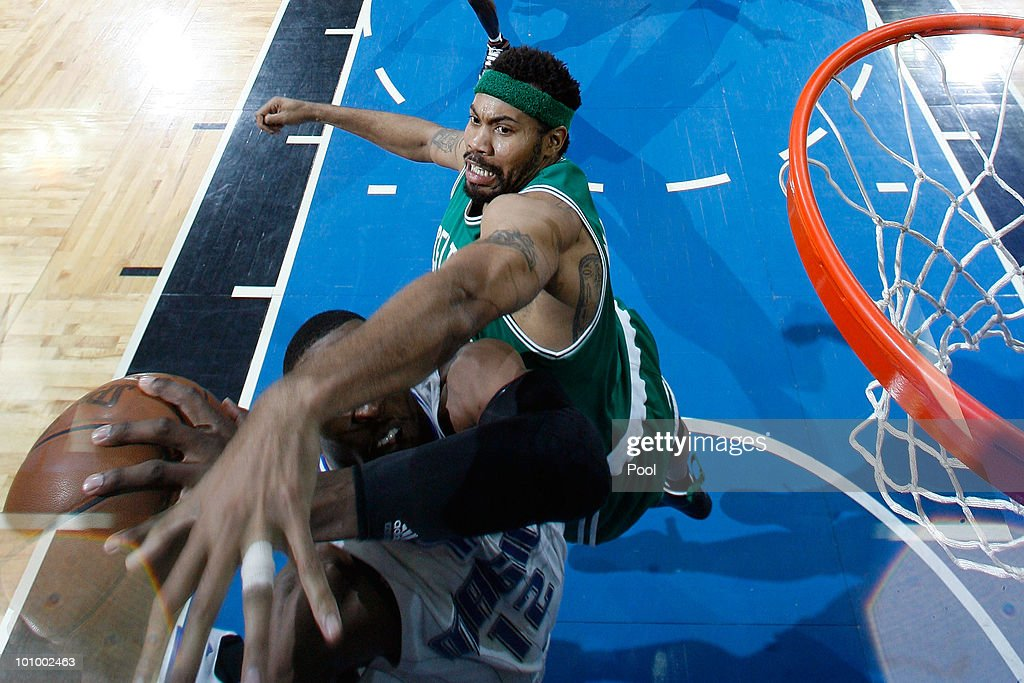 <a gi-track='captionPersonalityLinkClicked' href=/galleries/search?phrase=Rasheed+Wallace&family=editorial&specificpeople=201483 ng-click='$event.stopPropagation()'>Rasheed Wallace</a> #30 of the Boston Celtics defends against <a gi-track='captionPersonalityLinkClicked' href=/galleries/search?phrase=Dwight+Howard&family=editorial&specificpeople=201570 ng-click='$event.stopPropagation()'>Dwight Howard</a> #12 of the Orlando Magic in Game Five of the Eastern Conference Finals during the 2010 NBA Playoffs at Amway Arena on May 26, 2010 in Orlando, Florida.