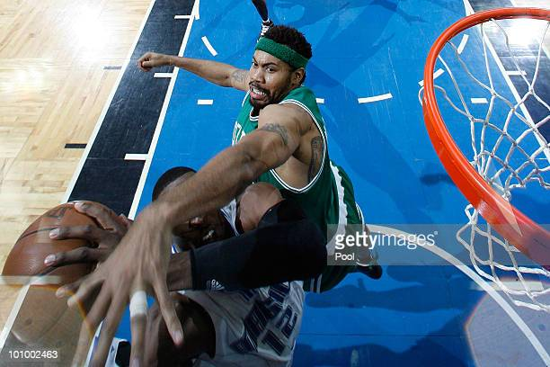 Rasheed Wallace of the Boston Celtics defends against Dwight Howard of the Orlando Magic in Game Five of the Eastern Conference Finals during the...