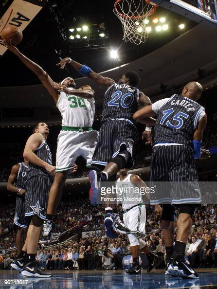 Rasheed Wallace of the Boston Celtics shoots against Mickael Pietrus of the Orlando Magic during the game on January 28 2010 at Amway Arena in...