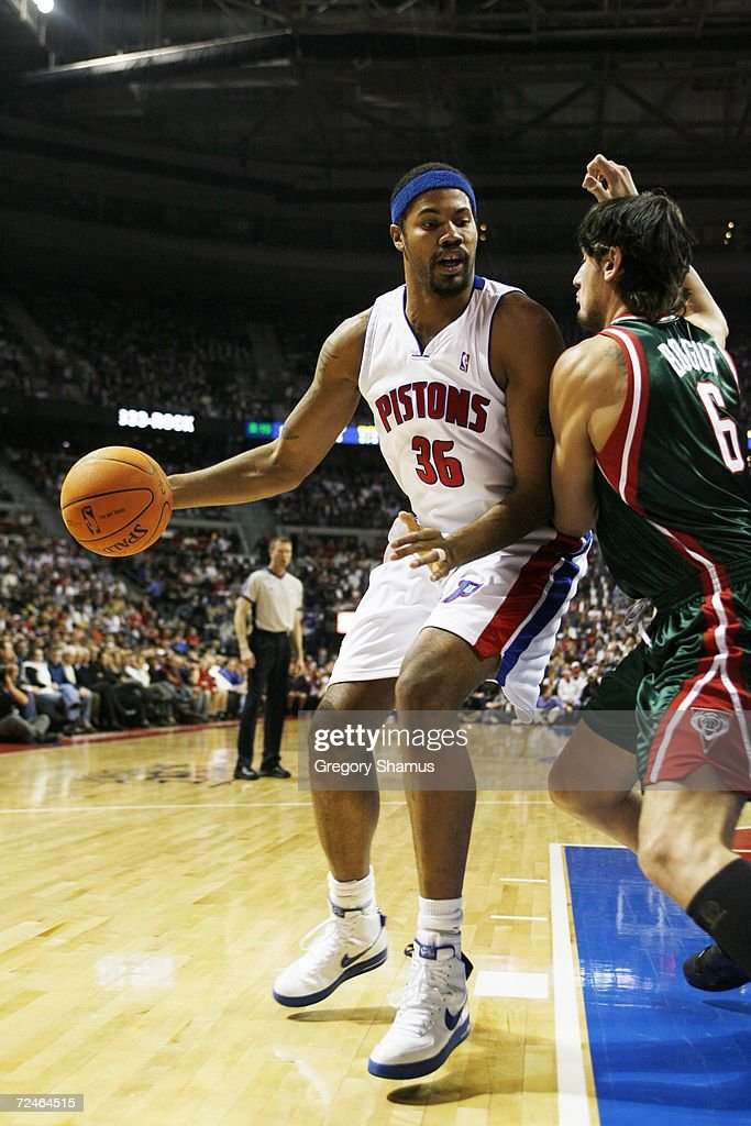 Rasheed Wallace #36 of the Detroit Pistons dribbles against Andrew Bogut #6 of the Milwaukee Bucks on November 1, 2006 at the Palace of Auburn Hills in Auburn Hills, Michigan. Milwaukee won the game 105-97.