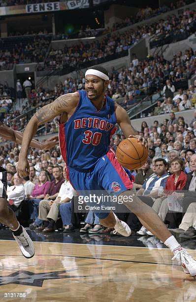 Rasheed Wallace of the Detroit Pistons drives against the San Antonio Spurs March 25 2004at the SBC Center in San Antonio Texas NOTE TO USER User...