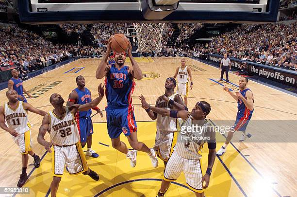Rasheed Wallace of the Detroit Pistons drives to the basket against Stephen Jackson Jermaine O'Neal and Dale Davis of the Indiana Pacers in Game six...