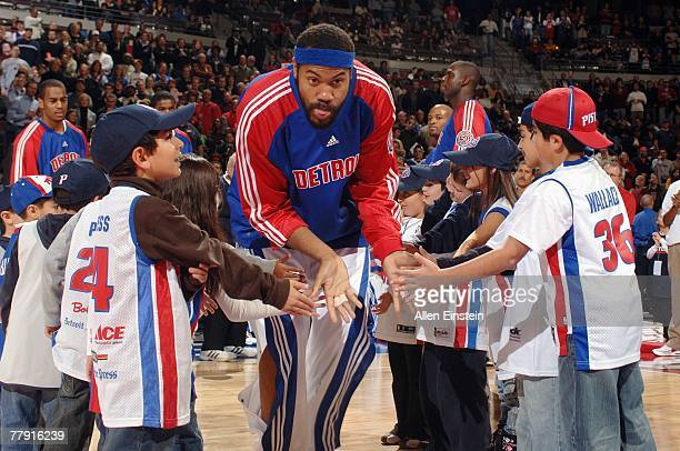 Rasheed Wallace of the Detroit Pistons highfives a group of young Piston fans as he enters the court during player introductions prior to the game...