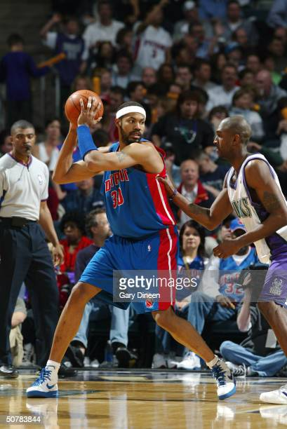 Rasheed Wallace of the Detroit Pistons is covered by Joe Smith of the Milwaukee Bucks in Game four of the Eastern Conference Quarterfinals during the...