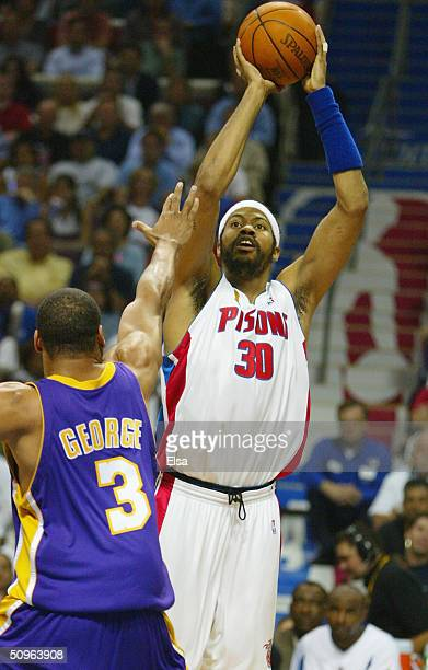 Rasheed Wallace of the Detroit Pistons shoots a jumpshot over Devean George of the Los Angeles Lakers during the first quarter in game five of the...