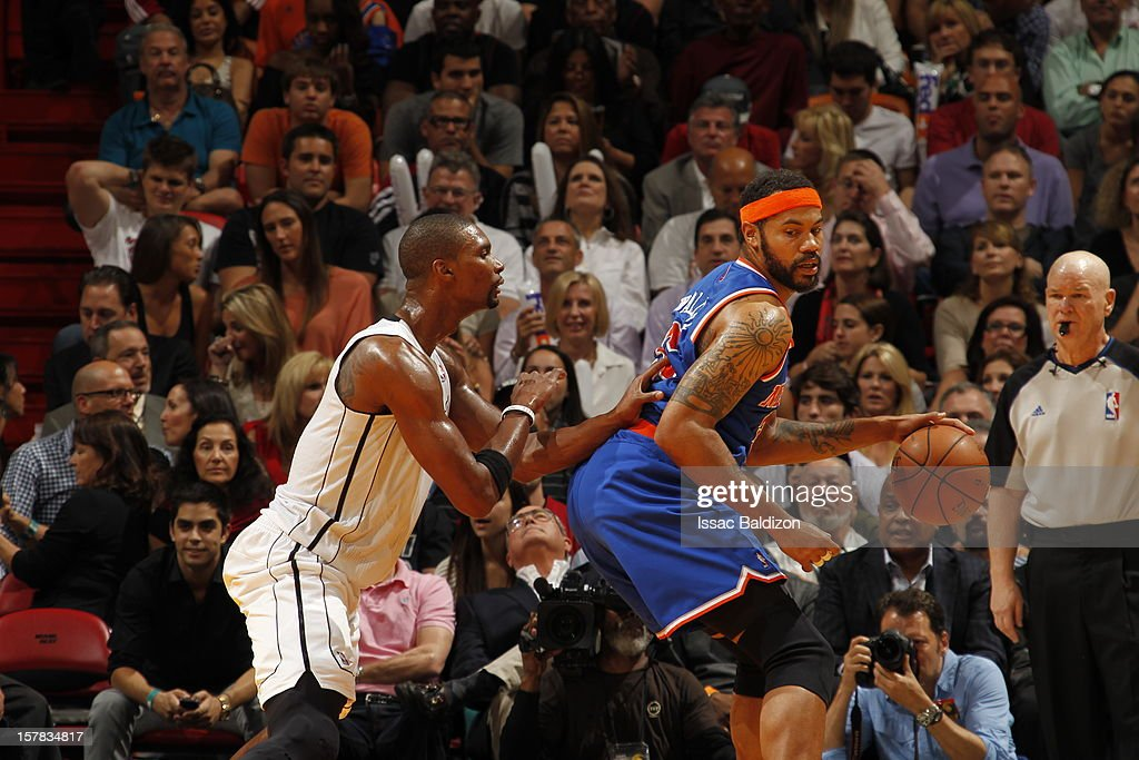 Rasheed Wallace #36 of the New York Knicks backs up Chris Bosh #1 of the Miami Heat during a game on December 6, 2012 at American Airlines Arena in Miami, Florida.