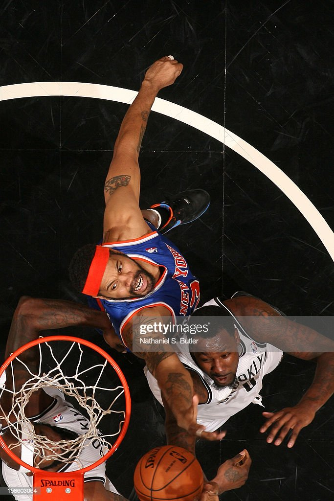<a gi-track='captionPersonalityLinkClicked' href=/galleries/search?phrase=Rasheed+Wallace&family=editorial&specificpeople=201483 ng-click='$event.stopPropagation()'>Rasheed Wallace</a> #36 of the New York Knicks grabs a rebound against the Brooklyn Nets on December 11, 2012 at the Barclays Center in the Brooklyn borough of New York City.