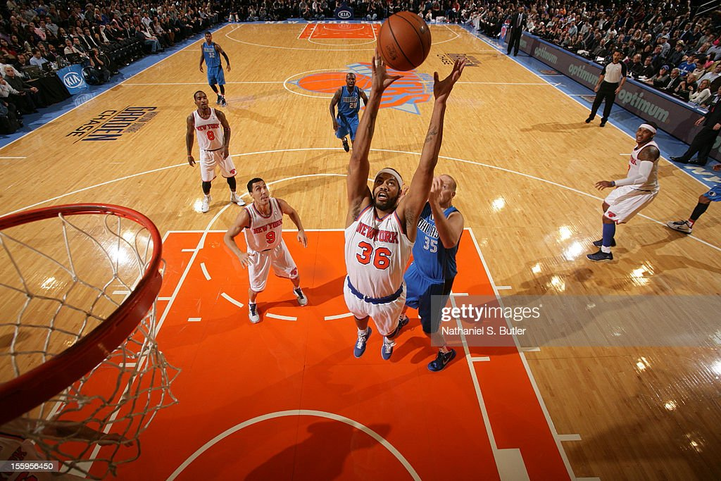 <a gi-track='captionPersonalityLinkClicked' href=/galleries/search?phrase=Rasheed+Wallace&family=editorial&specificpeople=201483 ng-click='$event.stopPropagation()'>Rasheed Wallace</a> #36 of the New York Knicks grabs a rebound over <a gi-track='captionPersonalityLinkClicked' href=/galleries/search?phrase=Chris+Kaman&family=editorial&specificpeople=201661 ng-click='$event.stopPropagation()'>Chris Kaman</a> #35 of the Dallas Mavericks during the game on November 9, 2012 at Madison Square Garden in New York City.