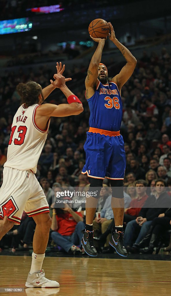 Rasheed Wallace #36 of the New York Knicks puts up a three point shot over Joakim Noah #13 of the Chicago Bulls at the United Center on December 8, 2012 in Chicago, Illinois.