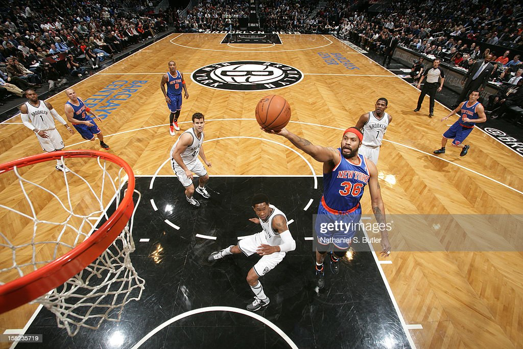 Rasheed Wallace #36 of the New York Knicks shoots against MarShon Brooks #9 of the Brooklyn on Nets December 11, 2012 at the Barclays Center in the Brooklyn borough of New York City.