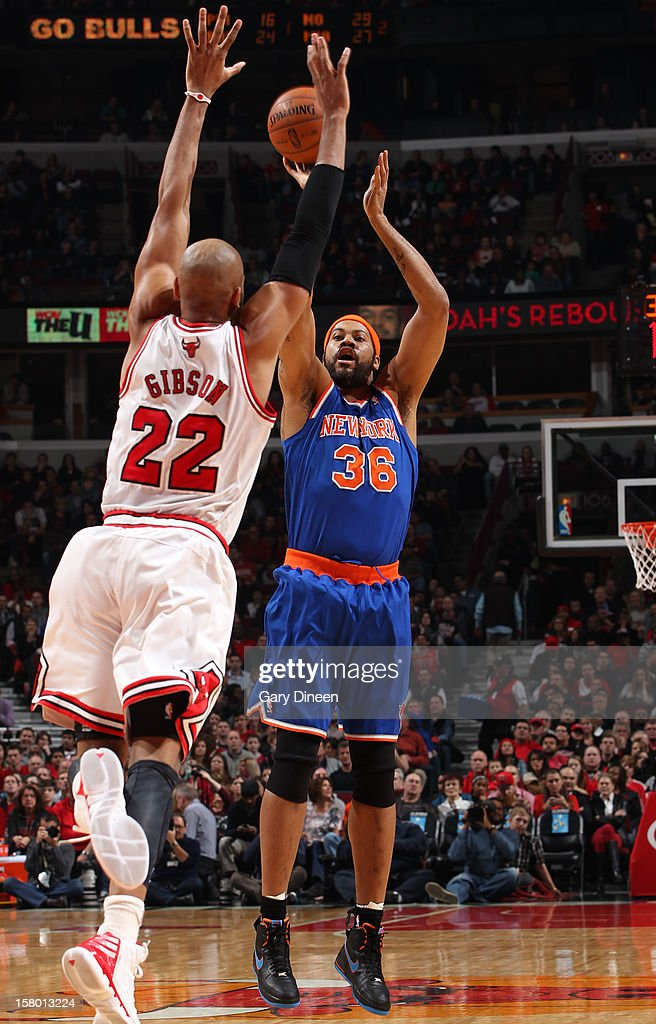 Rasheed Wallace #36 of the New York Knicks shoots against Taj Gibson #22 of the Chicago Bulls on December 8, 2012 at the United Center in Chicago, Illinois.