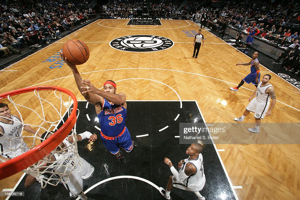 Rasheed Wallace #36 of the New York Knicks shoots against the Brooklyn on Nets December 11, 2012 at the Barclays Center in the Brooklyn borough of New York City.