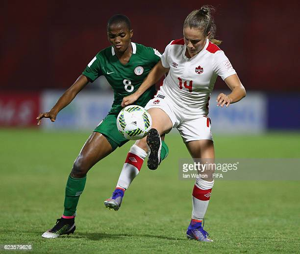Rasheedat Busayo Ajibade of Nigeria tries to tackle Emma Rose Regan of Canada during the FIFA U20 Women's World Cup Group B match between Nigeria and...