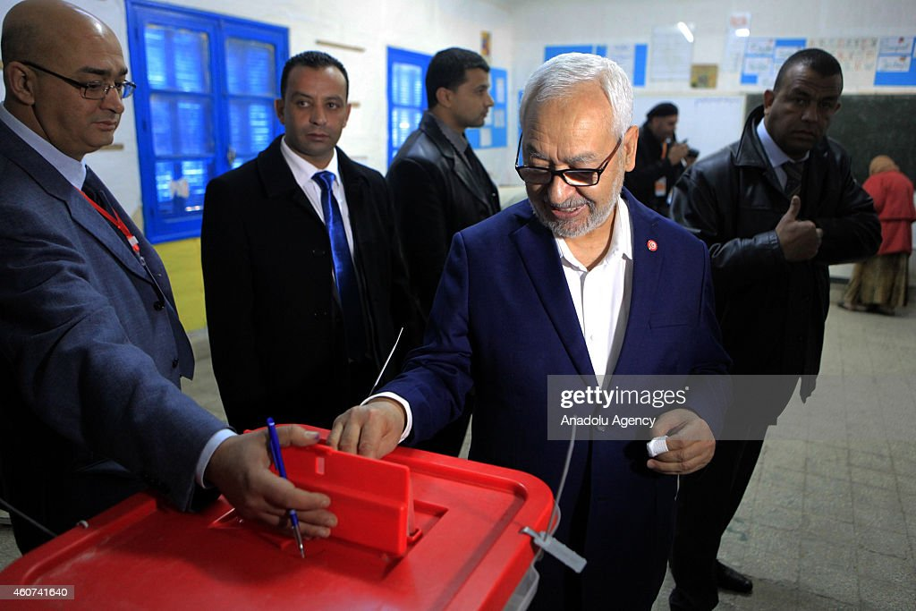 Rashid al-Ghannushi (R) leader of Ennahda Movement casts his vote at Nahc al-Keyrevan school during the second round of Tunisia's presidential election in Ben Arous, Tunis on December 21, 2014.