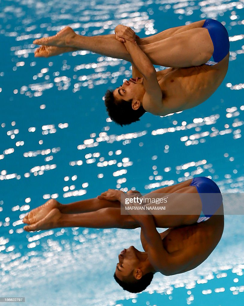 Rashid al-Harbi and Hussein al-Qallaf of Kuwait perform in the men's synchronised 3m springboard diving comptition at the 9th Asian Swimming Championships in Dubai, on November 22, 2012.