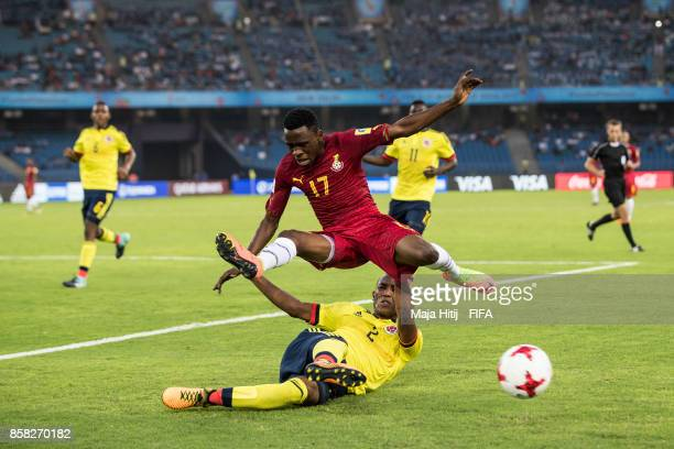 Rashid Alhassan of Ghana and Andres Cifuentes of Columbia battle for the ballduring the FIFA U17 World Cup India 2017 group A match between Colombia...