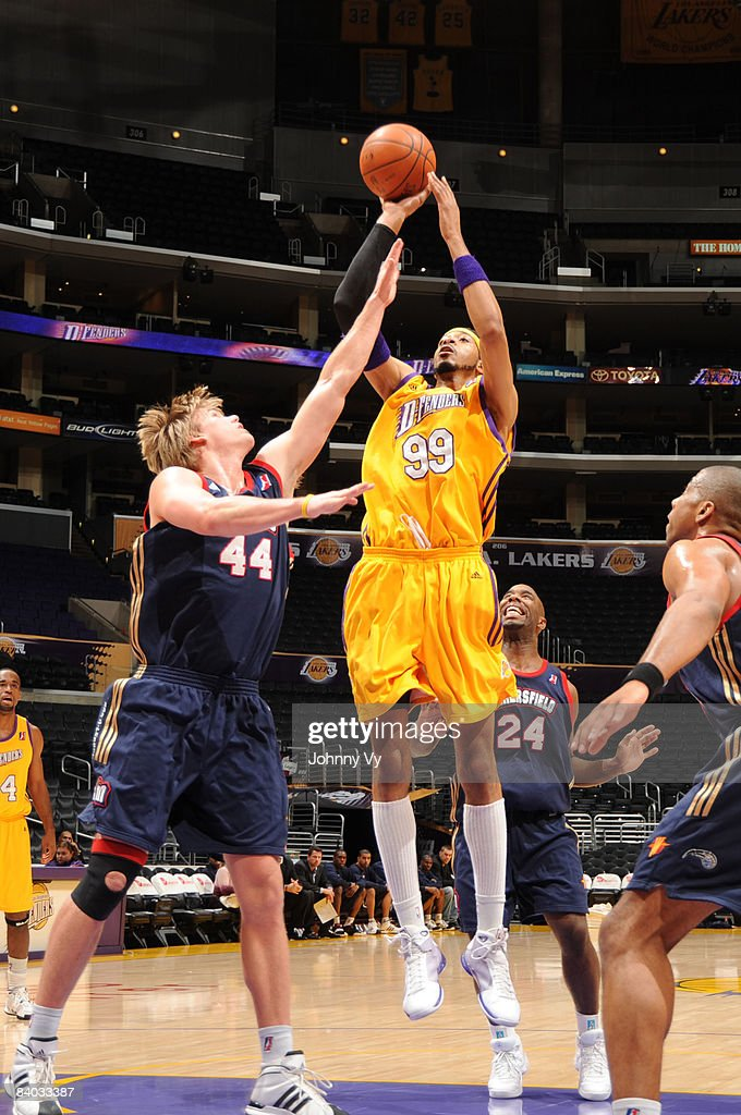 Rashid Byrd of the Los Angeles DFenders shoots against Nick Lewis of the Bakersfield Jam at Staples Center on December 14 2008 in Los Angeles...