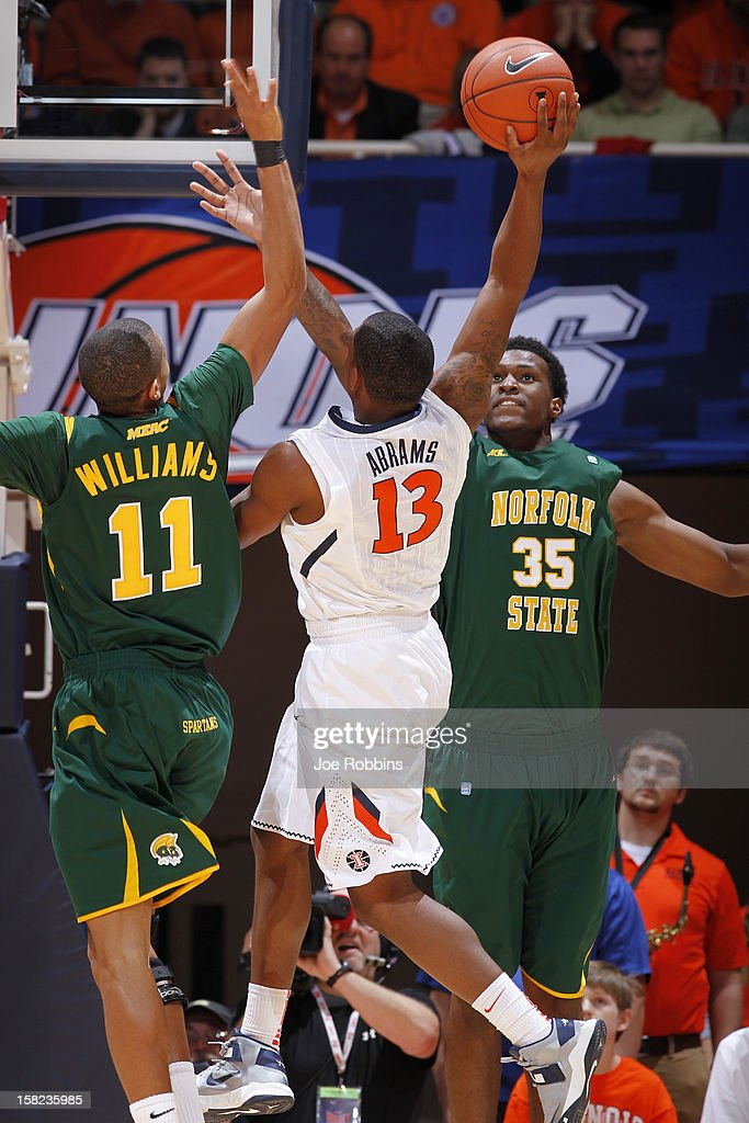 Rashid Gaston #35 and Pendarvis Williams #11 of the Norfolk State Spartans defend against Tracy Abrams #13 of the Illinois Fighting Illini during the game at Assembly Hall on December 11, 2012 in Champaign, Illinois. Illinois won 64-54.