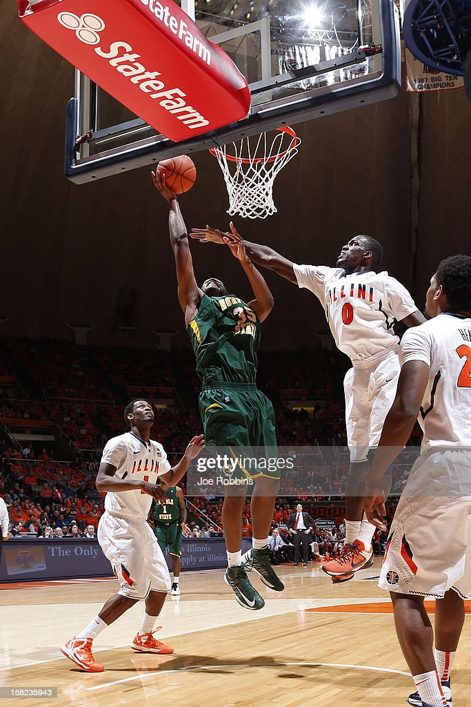 Rashid Gaston #35 of the Norfolk State Spartans goes to the basket against Sam McLaurin #0 of the Illinois Fighting Illini during the game at Assembly Hall on December 11, 2012 in Champaign, Illinois. Illinois won 64-54.