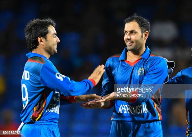 Rashid Khan and Mohammad Nabi of Afghanistan celebrate the dismissal of Chadwick Walton of West Indies during the 2nd T20i match between West Indies...