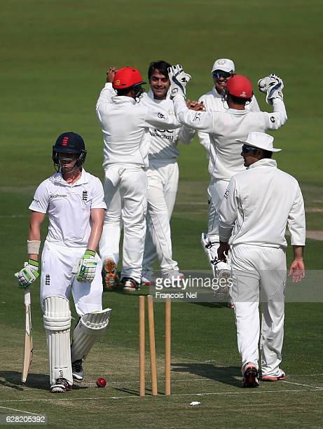 Rashid Khan of Afghanistan celebrate with teammates after dismissing Joe Clarke of England Lions during day one of the tour match between England...