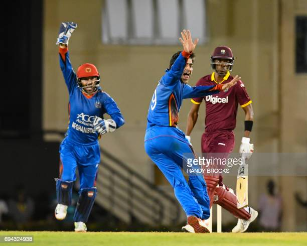 Rashid Khan of Afghanistan dismisses Roston Chase of West Indies during the 1st ODI match between West Indies and Afghanistan at Darren Sammy...