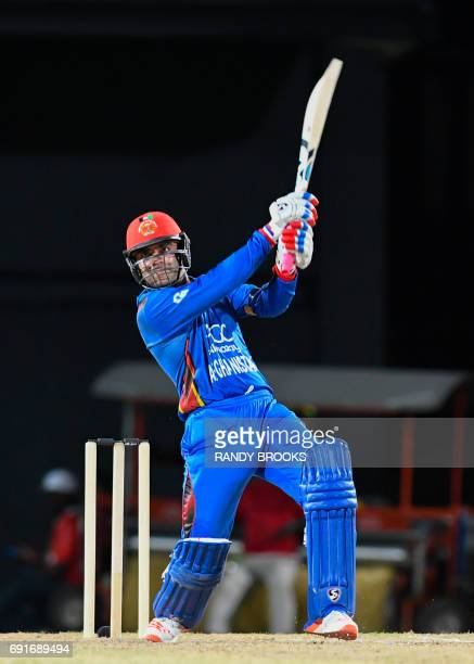 Rashid Khan of Afghanistan hits a 6 during the 1st T20i match between West Indies and Afghanistan at Warner Park Basseterre St Kitts June 2 2017 /...