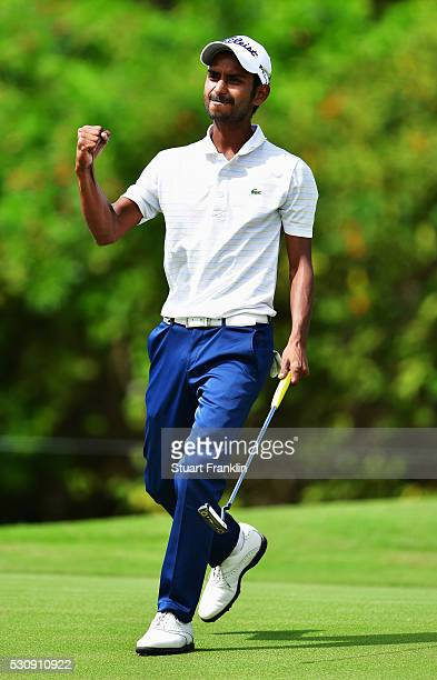 Rashid Khan of India celebrates a birdie putt during the first round of AfrAsia Bank Mauritius Open at Four Seasons Golf Club Mauritius at Anahita on...