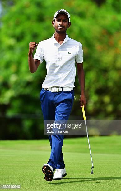 Rashid Khan of India celebrates a birdie putt during the first round of AfrAsia Bank Mauritius Open at Four Seasons Golf Club Mauritius at Anahita on...