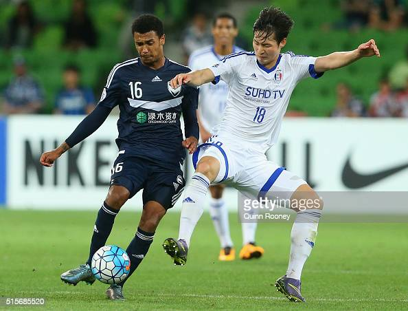 Rashid Mahazi of the Victory and Kim Jongmin of Suwon compete for the ball during the AFC Champions League match between the Melbourne Victory and...