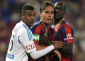 Rashid Mahazi of the Victory James Brown and Emile Heskey of the Jets wait for a corner kick during the round 14 ALeague match between the Newcastle...