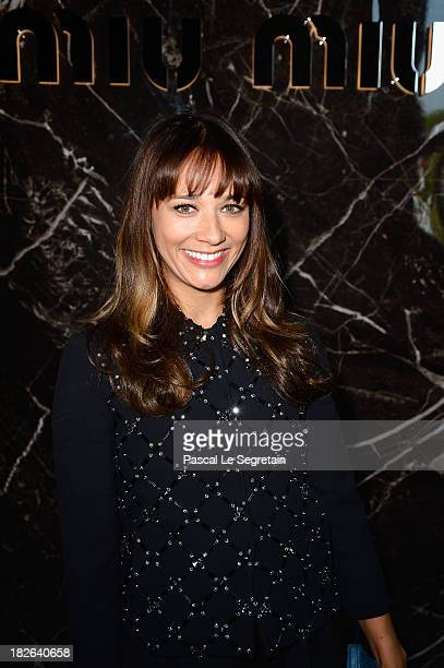 Rashida Jones attends the Miu Miu show as part of the Paris Fashion Week Womenswear Spring/Summer 2014 at Palais d'Iena on October 2 2013 in Paris...