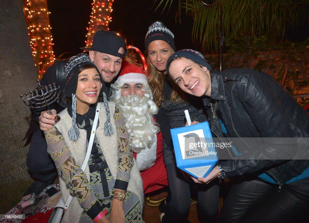 Rashida Jones, Benji Madden, Santa Claus, Charlotte Ronson and Samantha Ronson attend the I Heart Ronson Holiday Party at The Bungalow on December 11, 2012 in Santa Monica, California.