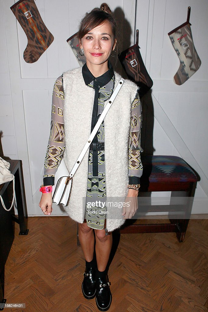 Rashida Jones pose at the I Heart Ronson Holiday Party at The Bungalow on December 11, 2012 in Santa Monica, California.