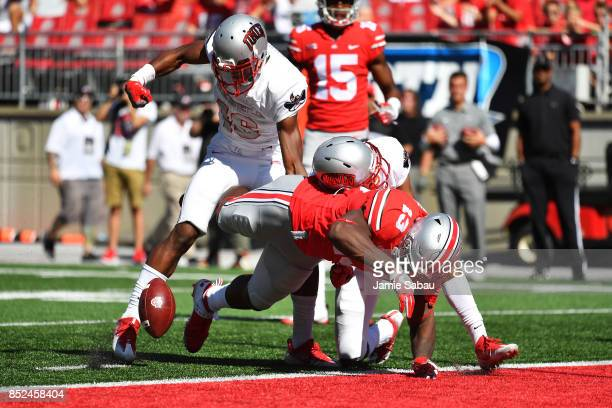 Rashod Berry of the Ohio State Buckeyes fumbles the ball on the goal line after Javin White of the UNLV Rebels stripped the ball in the fourth...