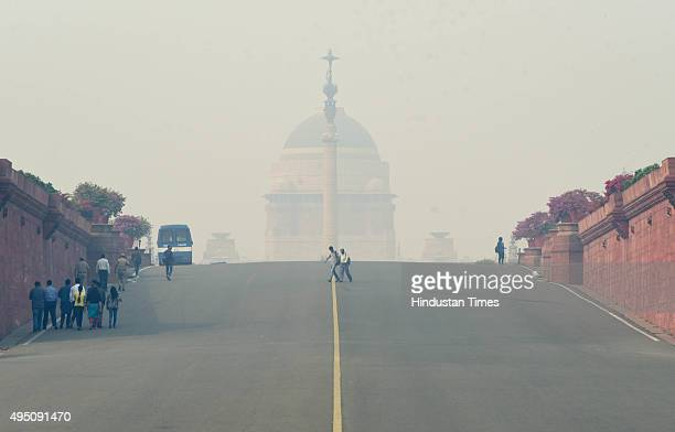 Rashtrapati Bhawan gets hazy because of the smogforming weather on October 31 2015 in New Delhi India The high pollution levels in DelhiNCR also...