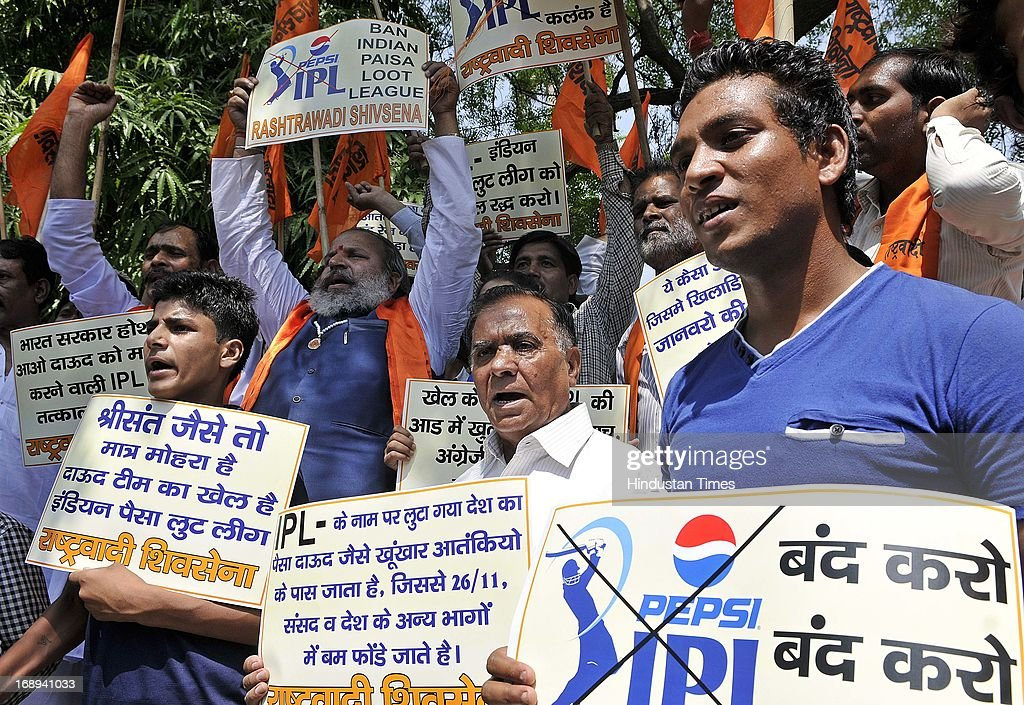Rashtrawadi Shiv Sena activists raise slogans as they demand ban on the IPL cricket during a demonstration at the Jantar Mantar on May 17, 2013 in New Delhi, India. Delhi Police have arrested three players of IPL team Rajasthan Royals for spot-fixing.