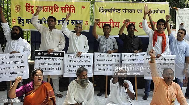 Rashtriya Hindu Andolan activists protest demanding strict laws to stop Love Jihad at Jantar Mantar on September 14 2014 in New Delhi India Love...