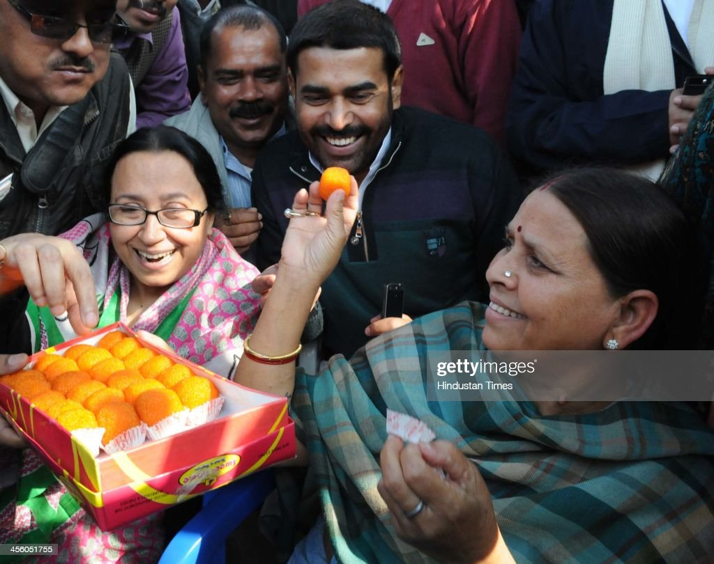 Rashtriya Janata Dal (RJD) leader Rabri Yadav distributes sweets after party supremo and her husband Lalu Prasad Yadav was granted bail in fodder scam by Supreme Court on December 13, 2013 in Patna, India. Former Bihar Chief Minister Lalu Yadav was convicted on September 30, by a special CBI court in the fodder scam case involving fraudulent withdrawal of 37.7 crore rupees from Chaibasa Treasury during the RJD regime.