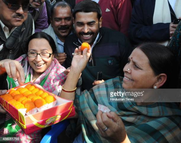 Rashtriya Janata Dal leader Rabri Yadav distributes sweets after party supremo and her husband Lalu Prasad Yadav was granted bail in fodder scam by...