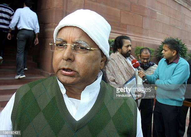 Rashtriya Janata Dal President Lalu Prasad Yadav arrives to attend the allparty meeting on the issue of FDI in retail during the Parliament winter...