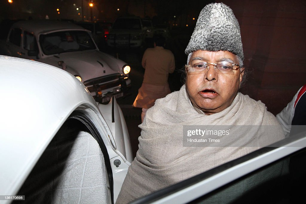 Rashtriya Janta Dal Chief <a gi-track='captionPersonalityLinkClicked' href=/galleries/search?phrase=Lalu+Prasad+Yadav&family=editorial&specificpeople=622942 ng-click='$event.stopPropagation()'>Lalu Prasad Yadav</a> walks out during the discussion on Lokpal Bill in Lok Sabha at Parliament house on December 27, 2011 in New Delhi, India. The Lokpal bill was passed by voice vote with 10 amendments, however the Left parties, SP and BSP walked out in protest before the voting.